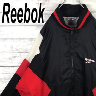 リーボック(Reebok)のリーボック ナイロン オーバーサイズ ブルゾン ヴィンテージ ゆるだぼ 黒 赤 (ナイロンジャケット)