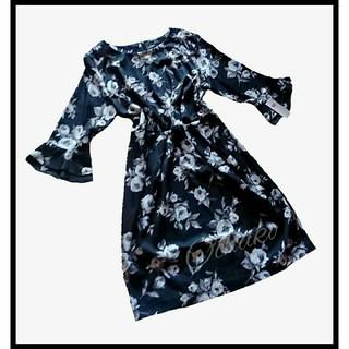 リュリュ(RyuRyu)の【新 品】☆ 大きいサイズ3L / 総花プリントの七分お袖のフリルワンピース ☆(ひざ丈ワンピース)