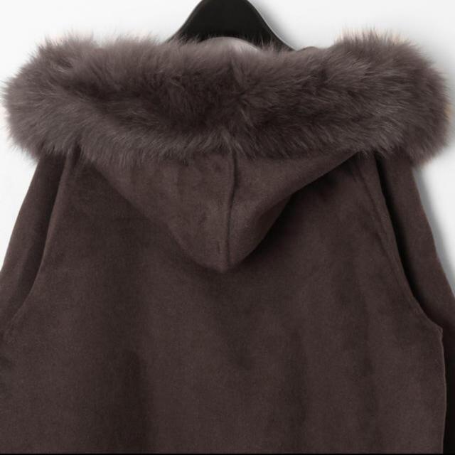 GRACE CONTINENTAL(グレースコンチネンタル)のポンチョ風トリミングコート レディースのジャケット/アウター(毛皮/ファーコート)の商品写真