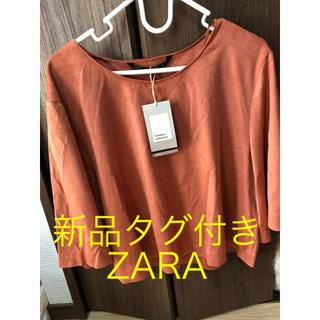 ザラ(ZARA)の新品タグつき ZARAスヌード トップス S オレンジ(カットソー(長袖/七分))