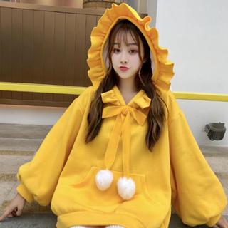 スタイルナンダ(STYLENANDA)の新品 韓国 フリルフード   ポンポン スウェット 黄色(トレーナー/スウェット)