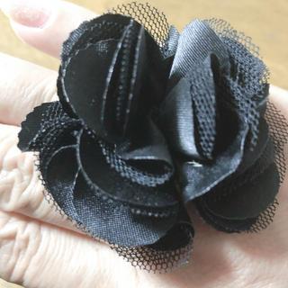 お花の指輪(未使用品)黒(リング(指輪))
