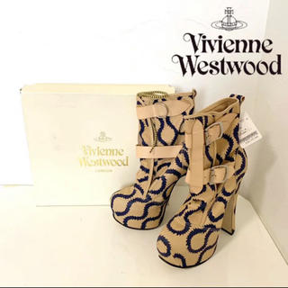 ヴィヴィアンウエストウッド(Vivienne Westwood)の【新品】ヴィヴィアンウエストウッド ブーツ パイソン ヒール ベージュ 23(ブーツ)