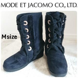 モードエジャコモ(Mode et Jacomo)のリボン付きムートンブーツ 黒(ブーツ)