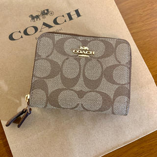 COACH - 新品・正規品♡coach シグネチャー柄折り財布 ライトブラウン