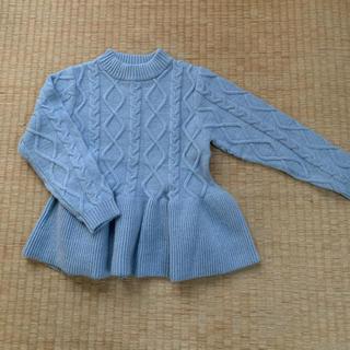 petit main - 裾フレアケーブル編みニット