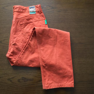 ベネトン(BENETTON)のW31L33 BENETTON パンツ オレンジ(カジュアルパンツ)
