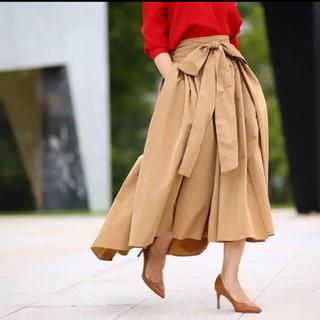 ツルバイマリコオイカワ(TSURU by Mariko Oikawa)のSHE Tokyo フレア スカート リボン キャメル 36 クリーニング済み(ロングスカート)