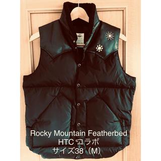 ロッキーマウンテンフェザーベッド(Rocky Mountain Featherbed)のロッキーマウンテン HTCコラボ ダウンベスト 美品 M(ダウンベスト)