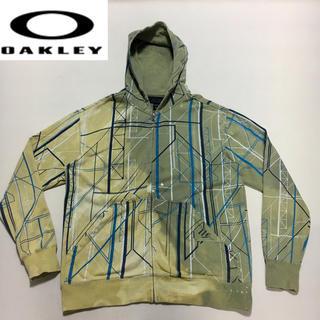 オークリー(Oakley)のOAKLEY オークリー パーカー◆カーキ 総柄 Sサイズ 海外モデル(パーカー)