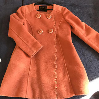 セシルマクビー(CECIL McBEE)のくすみオレンジコート(ロングコート)
