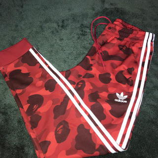 A BATHING APE - A Bathing Ape x Adidas track pants red