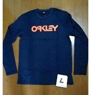 オークリー(Oakley)のOAKLEYサイズL (US M)ロゴロンT ネイビーL 未使用タグ付(Tシャツ/カットソー(七分/長袖))