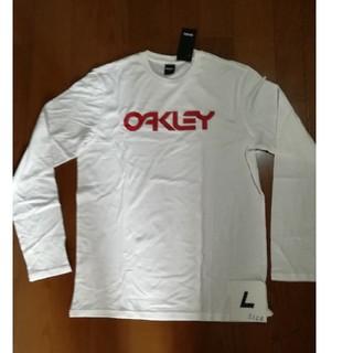 オークリー(Oakley)のOAKLEY サイズL ロゴロンT ホワイト/レッドL 未使用タグ付(Tシャツ/カットソー(七分/長袖))