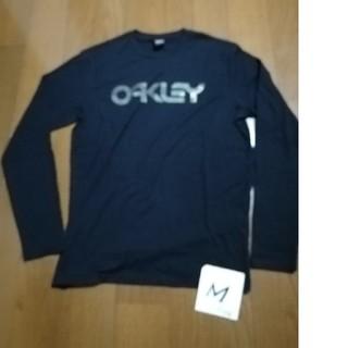 オークリー(Oakley)のOAKLEY サイズM (US S)迷彩ロゴロンT 黒M 未使用タグ付(Tシャツ/カットソー(七分/長袖))