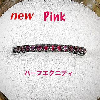 newブラックリング ピンク系色ストーンリング(リング(指輪))