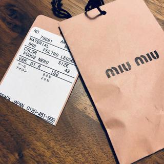 ミュウミュウ(miumiu)のミュウミュウ コート 黒 L(ピーコート)