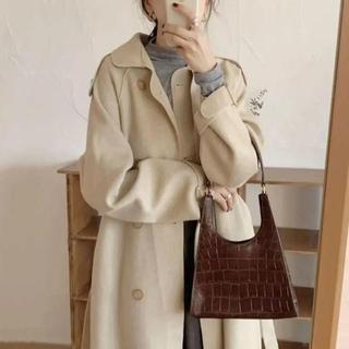 Lochie - beige coat.