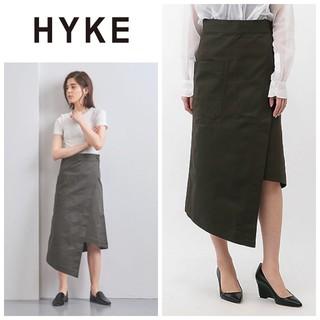 ハイク(HYKE)のhyke ハイク ラップデッキスカート アシンメトリー(ひざ丈スカート)
