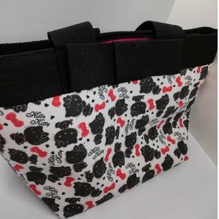 サンリオ(サンリオ)のオトナキティ 布製 ハンドバッグ チャーム付 大容量(ハンドバッグ)