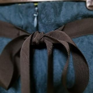 ウノビリエ(unobilie)のunobilie リボン付きスカート(ひざ丈スカート)