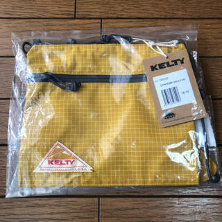 ケルティ(KELTY)のKELTY  サコッシュ 黄色 新品 未使用(ショルダーバッグ)