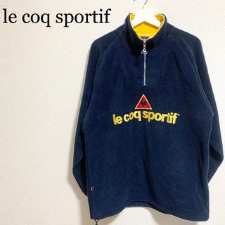 ルコックスポルティフ(le coq sportif)の90s ルコックスポルティフ フリース メンズM 紺 ハーフジップ 古着 ロゴ(その他)