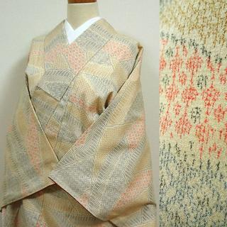 生成り色に青と朱色の柄 織りの小紋(着物)