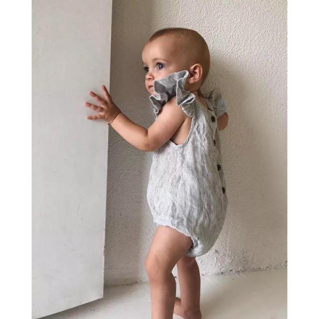 petit main(プティマイン)の袖フリルボーダーコットンロンパース・ベビーロンパース キッズ/ベビー/マタニティのベビー服(~85cm)(ロンパース)の商品写真