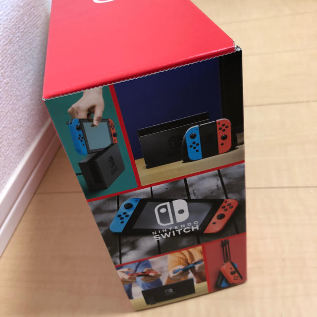 Nintendo Switch(ニンテンドースイッチ)の新型 新品未使用未開封 任天堂 スイッチ ネオンブルー  レッド 送料込み エンタメ/ホビーのゲームソフト/ゲーム機本体(家庭用ゲーム機本体)の商品写真