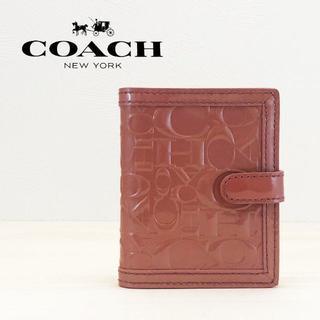 コーチ(COACH)の美品 コーチ エナメル カードケース ピンク(名刺入れ/定期入れ)