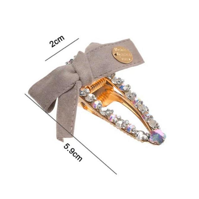 新品 ♡ リボン付き キラキラストーン クリップ 約6cm ♡ ヘアピン 髪留め レディースのヘアアクセサリー(バレッタ/ヘアクリップ)の商品写真