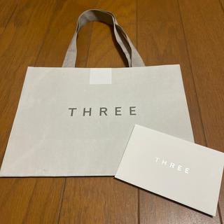 スリー(THREE)のTHREE ショッパー/メッセージカード/シール付(ショップ袋)