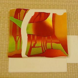 ベージュにオレンジと緑の柄 名古屋帯(帯)