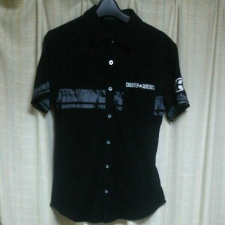 カウンターカルチャー(Counter Culture)のCOUNTER CULTURE 前開き ポロシャツ Mサイズ 黒 半袖シャツ 服(ポロシャツ)