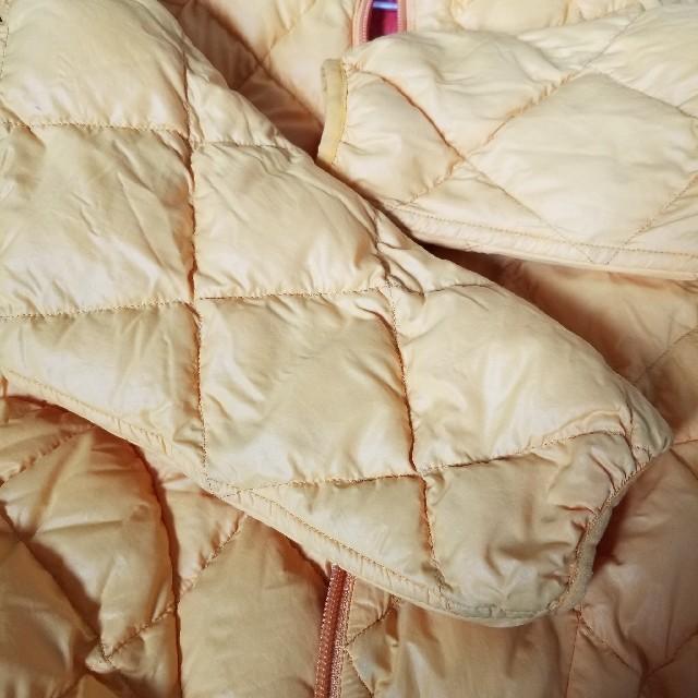 mont bell(モンベル)のmont-bell モンベル リバーシブルダウン110 赤に近いオレンジ キッズ/ベビー/マタニティのキッズ服女の子用(90cm~)(ジャケット/上着)の商品写真