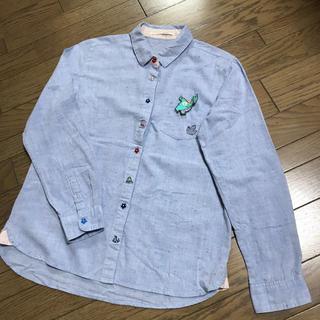 エスタコット(ESTACOT)のエスタコットESTACOT 恐竜ワッペン恐竜刺繍 水色ネップシャツ(シャツ/ブラウス(長袖/七分))