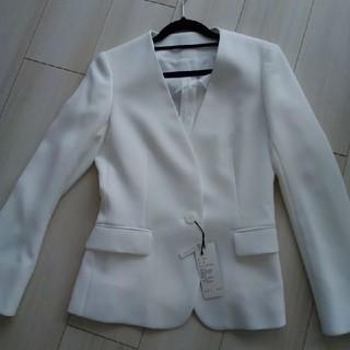 スーツカンパニー(THE SUIT COMPANY)のスーツカンパニー 白ジャケット新品 定価25000円くらいでした(ノーカラージャケット)