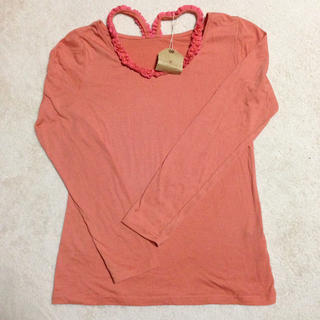 ジエンポリアム(THE EMPORIUM)のオレンジカラーTシャツ(Tシャツ(長袖/七分))