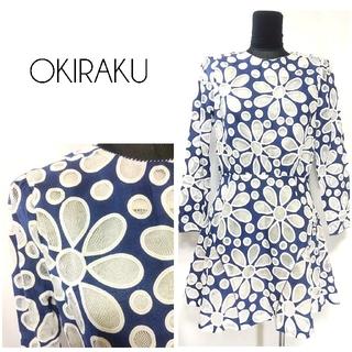 オキラク(OKIRAKU)のOKIRAKU オキラク 透け感 花柄 総柄 ワンピース XS 青 レディース(ミニワンピース)