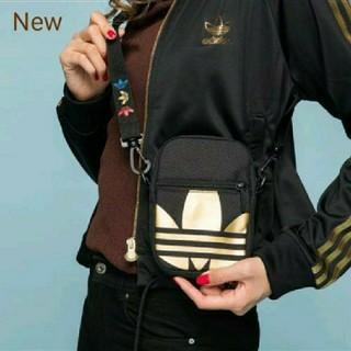 アディダス(adidas)の新品 adidas originals ポーチ フェスバッグ 黒×金(ボディバッグ/ウエストポーチ)