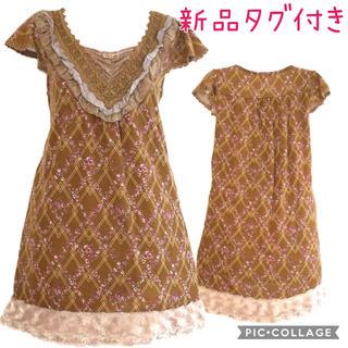 アクシーズファム(axes femme)の83.新品タグ付き 裾花柄ほっこりチュニ(チュニック)