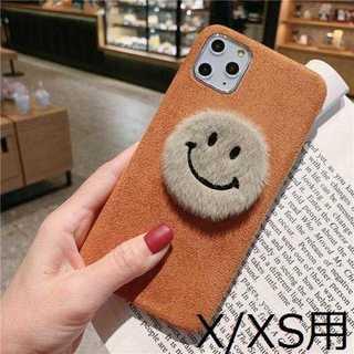 【iPhoneX/XS用】ブラウンのふわふわニコちゃんケース(iPhoneケース)