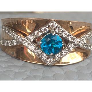 青い天然石とダイヤモンドの指輪です。
