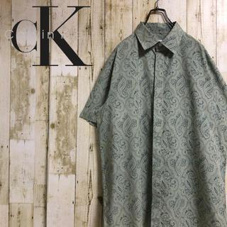 カルバンクライン(Calvin Klein)のCalvin Klein カルバンクライン ペイズリー 総柄 半袖シャツ カーキ(シャツ)