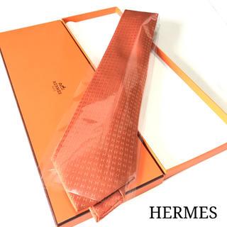 エルメス(Hermes)のHERMES エルメス H柄 ネクタイ(オレンジ、ツヤ感あり)(ネクタイ)