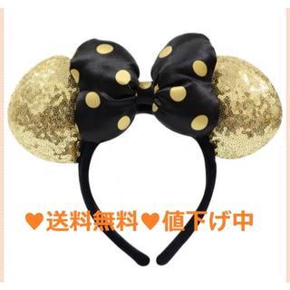 ディズニー(Disney)の海外ディズニーランド 新品ドットリボン ゴールドスパンコールカチューシャ(カチューシャ)