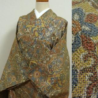 単衣 黄土色に亀甲と花々 紬(着物)