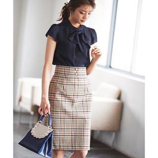 ①④パール釦付きチェックタイトスカート