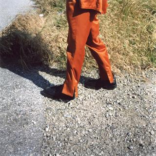 ジョンローレンスサリバン(JOHN LAWRENCE SULLIVAN)のrandy 19ss スリットフレアパンツ オリーブ(スラックス)